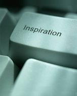 Computer key with the word inspiration on it