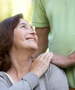 man putting hands on his mother's shoulder